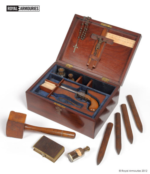 "A vampire slaying kit – inspired by 19th century folklore and fiction – has been bought at auction by the Royal Armouries Museum in Leeds. The fascinating kit comprises a mahogany casket, packed with everything a vampire hunter might need – including a pistol, crucifix, rosary beads, a bottle labelled holy water and even a mallet, plus four wooden stakes. The Royal Armouries secured the unusual lot at auction, organised by Tennants Auctioneers in Leyburn, North Yorkshire, after the box was left to a local woman in her uncle's will. It was probably compiled in the late 20th Century following the success of the Hammer Horror Movies and inspired by Bram Stoker's 1897 novel, Dracula. Royal Armouries Curator of Firearms, Jonathan Ferguson, said, These kits are often said to have been made as novelties in the Victorian period, but research shows they are later than this. We've yet to establish a firm date for our kit, but we know it will attract a lot of interest from our museum visitors. The mahogany box is split into two tiers. The top layer contains a percussion cap pistol with an octagonal barrel – for firing silver bullets. The lid holds a crucifix and rosary beads, to ward off 'evil spirits'. Other compartments contain three glass bottles, two of which are labelled holy water and another holy earth. As a 'last resort', there's a mallet and four wooden stakes, plus A Book of Common Prayer, dated 1857. A handwritten extract from the Bible, quoting Luke 19:27, reads, ""But those mine enemies, which would not that I should reign over them, bring hither, and slay them before me."" The kit will go on public display at the Clarence Dock museum – hopefully in time for Halloween 2012.  WANT!"