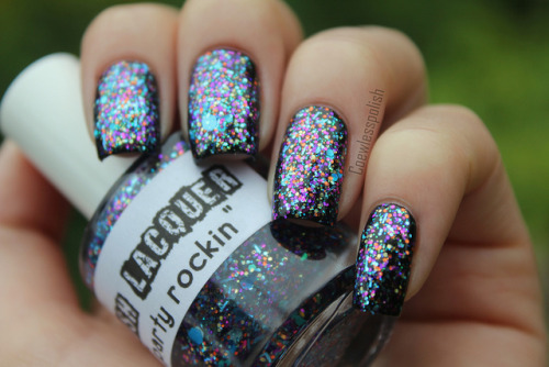 Party Rockin' over black on Flickr.This Lush Lacquer polish is amazing. Party in a bottle! LOVE! www.coewlesspolish.wordpress.com