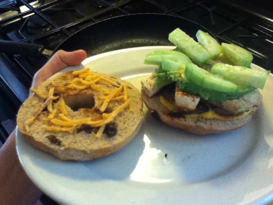 Cinnamon raisin bagel with daiya, mustard, cucumber, avocado, portabella mushrooms, and tofu. It's amazing.
