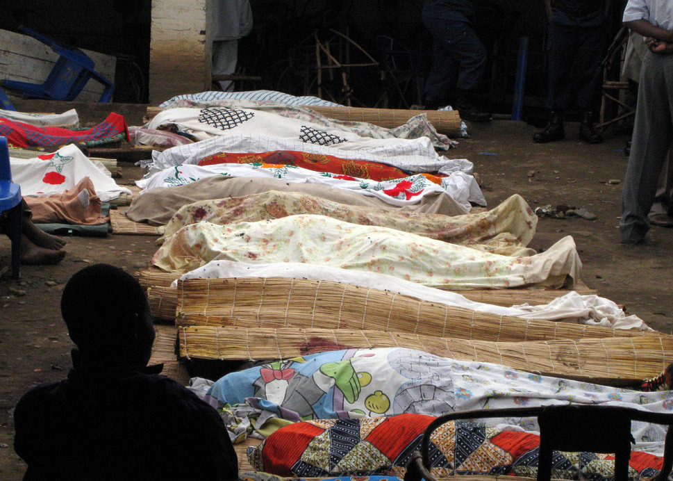 للموت قصة أخرى The bodies of victims of armed raiders are lined up for identification on Sept. 19, 2011, in the capital city of Bujumbura. Raiders killed at least 36 people when they stormed a Burundi bar and opened fire on patrons in one of the country's worst attacks in months. Esdras Ndikumana/AFP/Getty Images