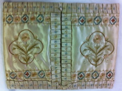 This is a silk hankerchief case that was made from a silk wedding dress in 1872. The inside was quilted and the outside embroidered. I didnt get a picture of the back but it had the couples names and wedding date on. A little different to a plastic pack of kleenex!