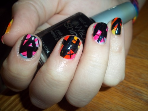 Geometric black over randomly applied neons.