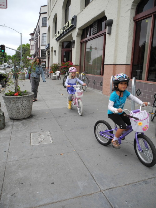 kids love to bike in oakland! 21.06.12. and check out all the bike racks in front of the gym! happy weekend :)