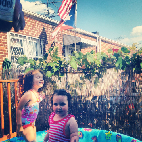 Adi rocking a kiddie pool at my aunt's in The Bronx