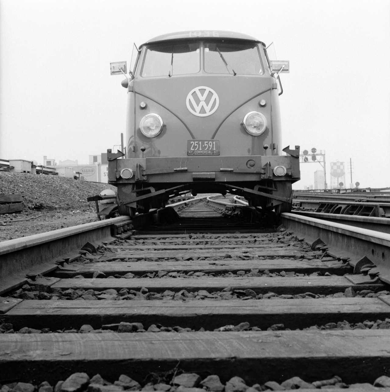 The new Volkswagen traveling along the tracks of the Long Island railroad, 1956.