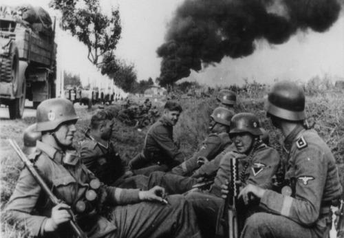 Soldiers of the SS-Leibstandarte Adolf Hitler Division, resting in a ditch alongside a road on the way to Pabianice, during the invasion of Poland in 1939. (LOC/Klaus Weill) [The Atlantic/In Focus]