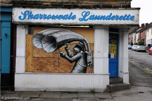 streetartglobal:  I took this photo of Phlegm's work in Sheffield last year. The street was steep and narrow and I wasn't sure if the launderette was closed for good. Phlegm's piece looks awesome, framed in the window! For our full Phlegm interview check this link.