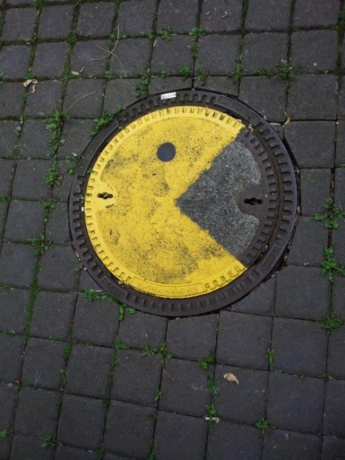 Pac-Manhole Cover Spotted in Göttingen, Germany; Mensa-Tower via: StreetArtNews