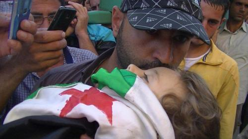 09/07/2012 | Horan, #Syria: A father bids his last farewell to child martyr Rayan Alamyan in Horan.