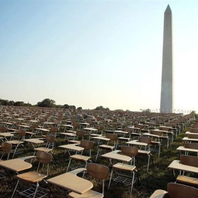 The non-profit organization College Board placed 857 empty school desks on the National Mall to represent the number of students who drop out of school every hour of the school day.