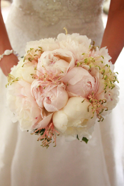 Peonies are the ultimate wedding flower! Fluffy and perfectly white, they mimic and accentuate that gorgeous wedding dress. We designed this bouquet for a beautiful June bride with a pink, white, and burlap color scheme.