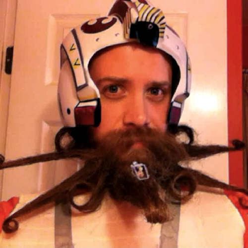 laughingsquid:  Beard in the Shape of a Star Wars X-Wing Fighter  Epic, but slightly creepy.