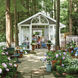 Romantic glass house. I LOVE the hydrangeas. Fav flower.