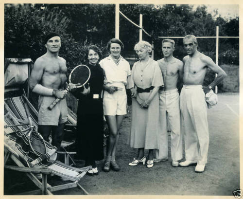 Playing tennis with Boris Karloff. The man behind the Frankenstein mask is on the far right.