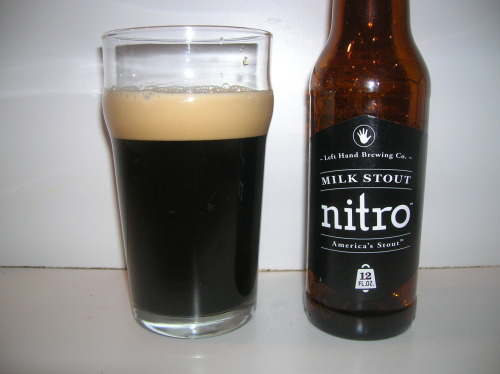 #369: Milk Stout Nitro – Left Hand Brewing Company, Longmont, Colorado I have to admit, I was downright giddy when I heard that Milk Stout Nitro was on the horizon. I rarely get giddy, but this did the trick. I thought the idea was absolutely brilliant. Left Hand Milk Stout was already a creamy, chocolatey treat, but a nitro version? I could hardly wait. And they somehow achieve nitro-like consistency and tightness without the use of a widget. I bet that cost them a lot of money, so let's see if it was worth all the trouble. It's brewed with Pale 2-row, Crystal, Munich, Roast Barley, Flaked Oats, Flaked Barley and Chocolate malt, and hopped with Magnum and Goldings. Checks in at 6% ABV. I had way, way too much fun pouring this beer, as can visually be witnessed in this video here (just make sure to tilt your head to the left when watching). I wanted to give you some motion photos (motion photos? What am I in the 1920s?) so you could get a better understanding of how this thing develops. It's quite interesting, as at first it appears a modest head is going to develop, but as the body violently clears itself and all of that matter comes gushing down, a tight, nitro-like creamy tan head suddenly builds into a proud pose. It's quite impressive. As was the aroma, which was riddled with rich milk chocolate, brown sugar and a touch of creamy coffee.  This is just damn lovely and wonderful. A beer after my own heart, really. It was love at first sight, and at first taste, and gulp, and second taste and second gulp. Really, a superb job they've done with this one. It has all of the creaminess and silkiness of a well-poured Guinness, but Milk Stout Nitro is a far, far, far richer beer than Guinness is. It's absolutely covered with notes of rich, creamy, decadent milk chocolate as the beer's silky texture greets you up front. Midway through there's notes of dry cocoa powder and mocha, coming together to create the impression that you're drinking a cappuccino with chocolate powder on top. It gracefully finishes with a hint of chocolate and just the slightest lactic tang, along with a delicate bitterness. The Verdict: Rich and full-bodied, yet silky, creamy and decadent. A true joy to drink. Best of luck to Left Hand with this. I wouldn't mind seeing this as the American alternative to draft Guinness at every bar in the future.