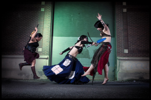 Submission ti… what? Bellydancing TARDIS with a lightsaber? You gotta be kidding me!  Cosplayers and submitters: Raks GeekPhotographer: Braden
