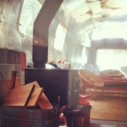 Interior of our airstream with wood burning stove (Taken with Instagram)