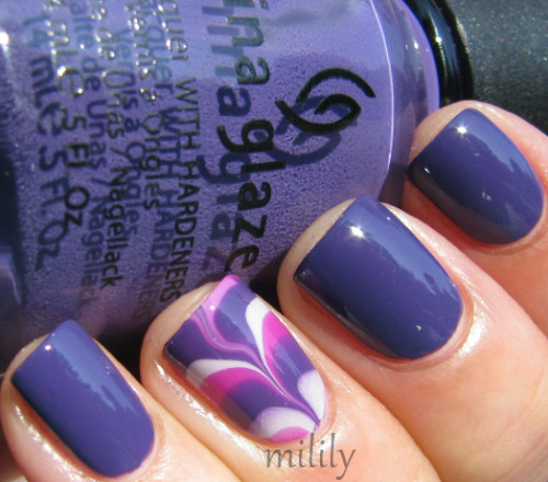mililypolish:  China Glaze Grape Pop with water marbled accent nail.  Accent colors:  Grape Pop, China Glaze Light As Air, and Color Club Gimme a Grape Big Kiss.
