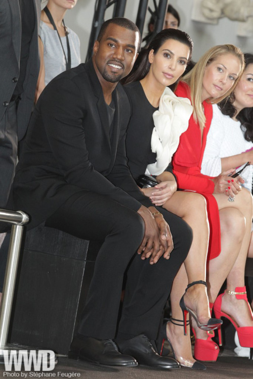 womensweardaily:  Kanye West and Kim Kardashian at Stéphane Rolland Blink, and you might have missed it. Kanye West and Kim Kardashian made a lightning appearance at the Stéphane Rolland couture show on Tuesday, sweeping to their seats shortly before the finale.  For more