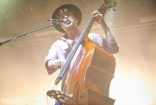 Ted Dwane of Mumford & Sons performing at Harvest of Art Festival in Wiesen, Austria on 6th July 2012. Photo copyright Max Tyler.