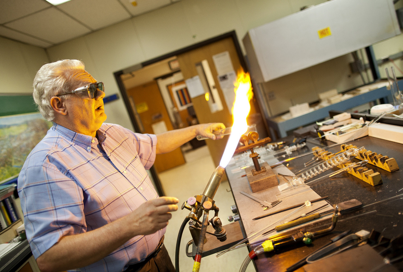 Harald W. Eberhart, Master Glass Blower in the Chemical Engineering Department at the College of Engineering at the University of Michigan, demonstrates some of the glass blowing techniques and products fro glass he has blown over the past 40 years. Eberhart is a second-generation glass blower, who began apprenticing under his father, Wolfgang R. Eberhart, at the age of 14. The elder Eberhart was one of the world's most renouned scientific glass blowers and was one of the youngest Master Glassblowers to graduate in the history of Austria. Employed at the University since 1991 and being one of 69 university master glass blowers in the United States (as of a 2005 survey), Harald Eberhart has been building both scientific apparatuses for various researchers and professors at the University, as well as more artistic pieces for CoE Dean David Munson, Jr. Image by Joseph Xu | Michigan Engineering Communications & Marketing