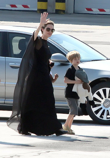 Apparently, shooting Maleficent has liberated Angelina Jolie and her witchy ways, because she is straight-up wearing black capes now. Also, this is our first glimpse of Shiloh in a while. Good to know she's still boring as ever.