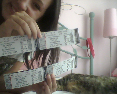 jus chillin; me, my cat and my one direction tickets that just came in the mail EXACTLY ONE YEAR AND ONE DAY TILL I SEE MY BABIES AGAIN