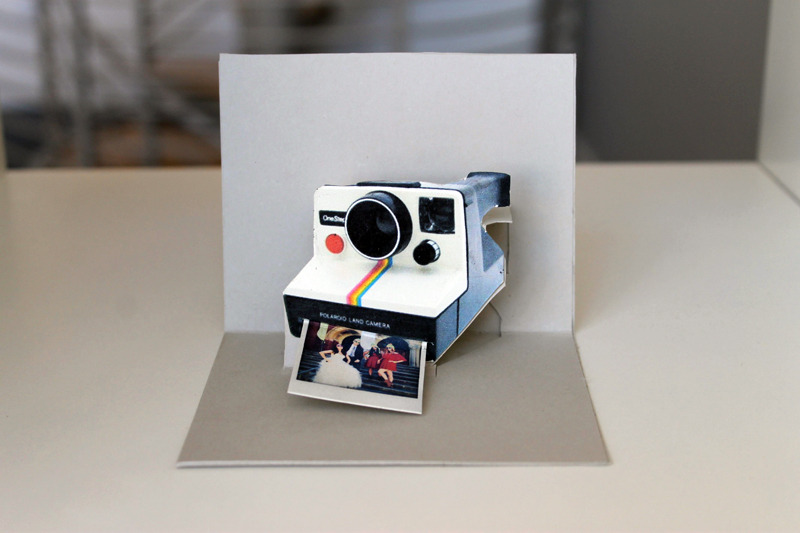 photojojo:  DIY: Surprise Friends with Polaroid Pop-Up Cards Our buddies at Brit & Co showed us how to make these pop-up Polaroid cards that actually delivers a tiny photo of you and your buddies! Send them as hellos in the mail or use them as name cards for your next dinner party.