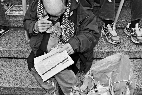 Homeless Man reading a newspaper , Manhattan 2012