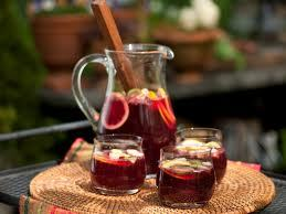 Just had FABULOUS sangria Weaseled the recipe out of the hostess It wasn't easy Had to get her tipsy on her own concoction first! Here's hoping she doesn't read my blog Ingredients: Table Red Franzia boxed wine 1/2 cup triple sec 1/2 cup peach schnapps 1/2 cup brandy 2 handfuls frozen fruit (buy the big bag from costco) 2 tablespoons of frozen OJ 2 tablespoons of frozen lemonade Ginger Ale Fill a gallon pitcher 3/4 with red wine, add rest of the ingredients, minus the ginger ale, place in refrigerator (ideally overnight) .. when you are ready to serve the sangria add enough ginger ale to fill the pitcher up the rest of the way