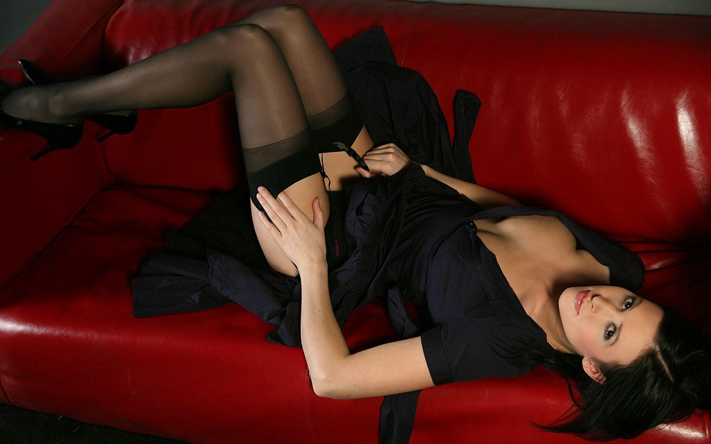 Sexy girl in black. Black hair, dress, panties, high heel shoes and black garter stockings. Extremly hot!