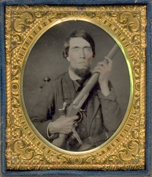 ca. 1860's, [ambrotype portrait of a gentleman in civilian attire, possessively holding a M1816 conversion musket with Bowie knife protruding from his belt] via Cowan's Auctions