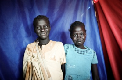 "Our South Sudan Country Director Mathieu Rouquette met these two little girls in the market in Bentiu, Unity State, when they peeked their heads into a camera shop that recently received a Mercy Corps business grant. ""They were pretty amazed looking at the pictures coming out the printer,"" he said. ""I asked my colleague Matthew to see if they wanted their own photo. They were so sweet, they smiled timidly, looking down. I had not realized that one of them was hearing impaired."" But photos communicate beyond words. After a taking a few pictures and hooking the camera up to the printer, ""Two copies of the picture came out. Their faces lit up, right before they stormed out of the little shop constructed of sheet metal."" These simple moments of hope and happiness can be rare in South Sudan, where ongoing conflict with Sudan has made violence, hunger and displacement a daily reality for hundreds of thousands of people. Read more."