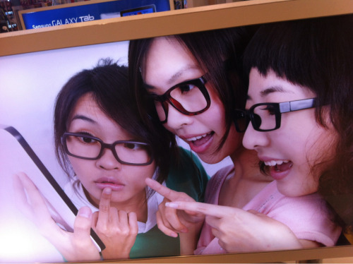 "Thinking of starting a new blog ""Asian women with glasses on (but don't have lenses in) looking at electronics"""