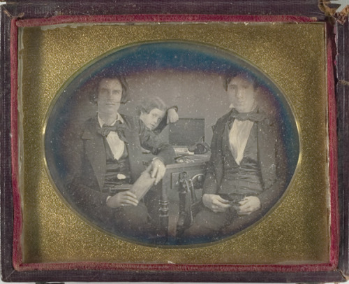 ca. 1850's, [daguerreotype portrait of two instrument repairmen and a child] via Cowan's Auctions