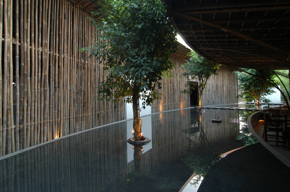 Pools at nWn Cafe in Bin Duong Province, Vietnam are cooling, reducing the need for air conditioning use. Designed by architectural firm, Vo Trang Nghia. There's a nice thing going on between the texture of the bamboo wall and the glassy smooth water. Trees coming out of the water…not bad.  Photo by Thu Thuy.
