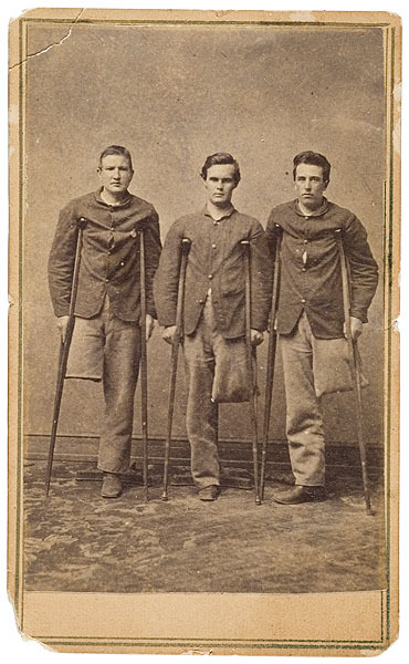 tuesday-johnson:  ca. 1860's, [carte de visite portrait of three young Federal soldier amputees all using hospital issue crutches. The boy at left wears a round metal identification disk pinned to his blouse], W. Snell via Cowan's Auctions