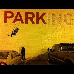 Little cous in front of banksy in dtown #banksy #parking #streetart #dtla #losangeles  (Taken with Instagram)