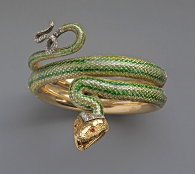 Snake from Belle Epoque period. French. Engraved gold, green enameling, ruby eyes, diamond accents.