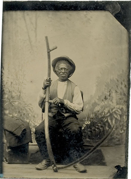 ca. 1870-80's, [tintype portrait of a farmer or share cropper with scythe] via Cowan's Auctions