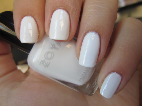 "zoya ""snow white"" i freaking love white nails in the summer.  this polish is kind of a bitch to deal with, needing almost 4 coats to be opaque.  but i love white nails so much that i'll put up with it until i finish the bottle."