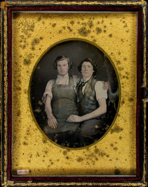tuesday-johnson:  ca. 1850's, [daguerreotype portrait of two gentlemen; one in a work shop apron sitting on the lap of another wearing plaid vest] via the Daguerreian Society, Greg French Collection