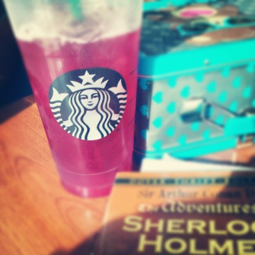 Passion tea lemonade with Sherlock Holmes. #sherlock #book #starbucks #food  (Taken with Instagram at Starbucks)