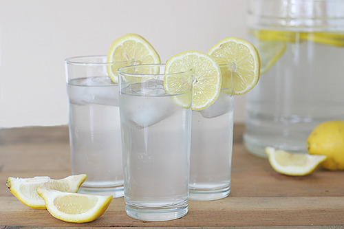 10 Reasons Why You Should Drink Lemon Water in the Morning  1. Boosts your immune system: Lemons are high in vitamin C, which is great for fighting colds.  They're high in potassium, which stimulates brain and nerve function. Potassium also helps control blood pressure. 2. Balances pH: Drink lemon water everyday and you'll reduce your body's overall acidity. Lemon is one of the most alkaline foods around. Yes, lemon has citric acid but it does not create acidity in the body once metabolized. 3. Helps with weight loss:   Lemons are high in pectin fiber, which helps fight hunger cravings. It also has been shown that people who maintain a more alkaline diet (see #2) lose weight faster.4. Aids digestion:  Lemon juice helps flush out unwanted materials. It encourages the liver to produce bile which is an acid that required for digestion. Efficient digestion reduces heartburn and constipation. 5. Is a diuretic: Lemons increase the rate of urination in the body, which helps purify it. Toxins are, therefore, released at a faster rate which helps keep your urinary tract healthy. 6. Clears skin:  The vitamin C component helps decrease wrinkles and blemishes. Lemon water purges toxins from the blood which helps keep skin clear as well. It can actually be applied directly to scars to help reduce their appearance. 7. Freshens breath: Not only this, but it can help relieve tooth pain and gingivitis. The citric acid can erode tooth enamel, so you should monitor this. I admit, I'm slightly worried about it. 8. Relieves respiratory problems: Warm lemon water helps get rid of chest infections and halt those pesky coughs. It's thought to be helpful to people with asthma and allergies too. 9. Keeps you zen: Vitamin C is one of the first things depleted when you subject your mind and body to stress. As mentioned previously, lemons are chock full of vitamin C. 10. Helps kick the coffee habit:  After I have a glass of hot lemon water, I actually don't crave coffee in the morning. This is weird, I can't explain it, but I'll take it.