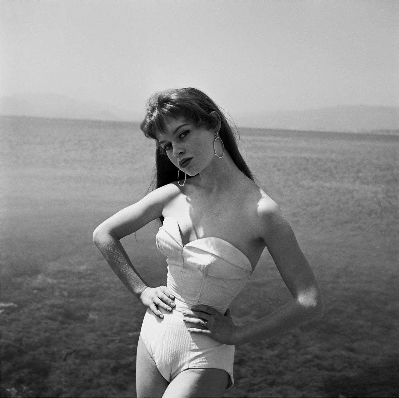 Hoops and Swimsuit. Accessorize with that one-piece. Here's Bridget Bardot at Cannes in 1955 via suicideblonde