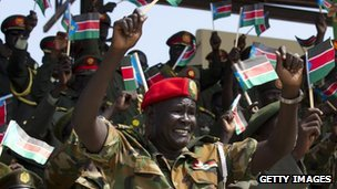 "South Sudan anniversary: Salva Kiir focuses on economy South Sudan's President Salva Kiir has said the world's newest country needs to be ""independent economically"" in his speech to mark the first anniversary of its independence. Thousands of people danced and waved flags during official celebrations in the capital, Juba. The BBC's Nyambura Wambugu, in Juba, says that few South Sudanese have seen much improvement in their lives. But she says that most feel it has been a good year, despite the problems. Our correspondent says it has also been a turbulent 12 months, with ethnic conflict in Jonglei State killing hundreds, conflict on the border with Sudan and a huge corruption scandal. 'Short man from Khartoum' Mr Kiir told the crowd: ""We still depend on others. Our liberty today is incomplete. We must be more than liberated. We have to be independent economically."" The official celebrations saw a military parade, featuring tanks and rocket launchers, while two helicopter flew South Sudan's flag over the heads of the cheering crowds. Pictured: Some have accused South Sudan of spending too much on its military"
