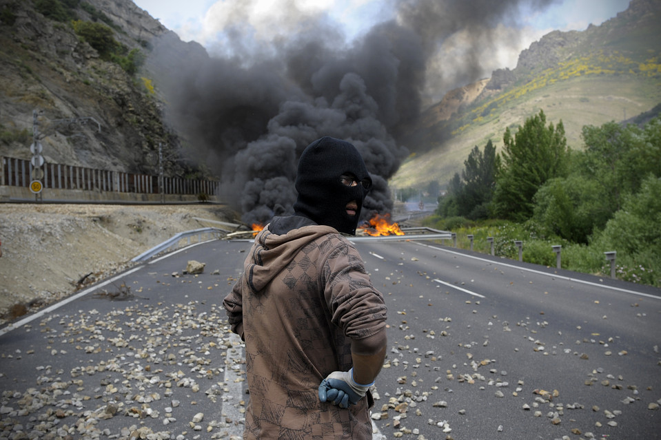A miner stood near a fire barricade after a clash with Civil Guard forces in Ciñera, Spain, Tuesday. Spanish coal miners are protesting against industry subsidy cuts that they say threaten tens of thousands of jobs. (Miguel Riopa/Agence France-Presse/Getty Images) June 19, 2012
