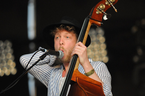 Ted Dwane of Mumford & Sons performs at Open'er Festival in Gdynia, Poland on July 7, 2012. Photo © Piotr Skrzypek.