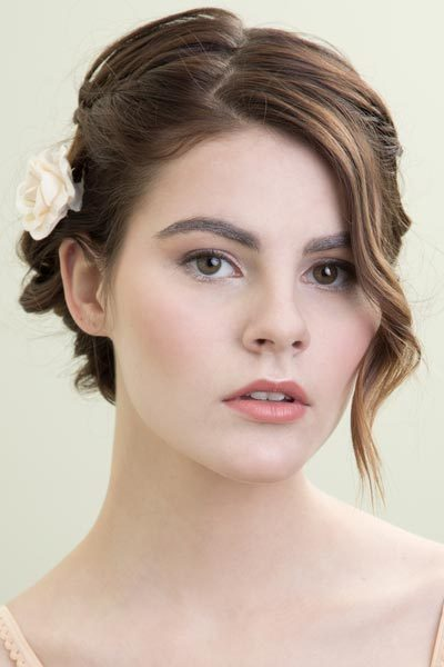 Short Wedding Hairstyles Add a special touch to your short wedding hairstyle with bridal hair accessories. Short wedding hair is fun and fabulous. Show off even more of your personal style on your special day with an accessory. There are so many options from vintage birdcage veils to regal tiaras to romantic flowers.