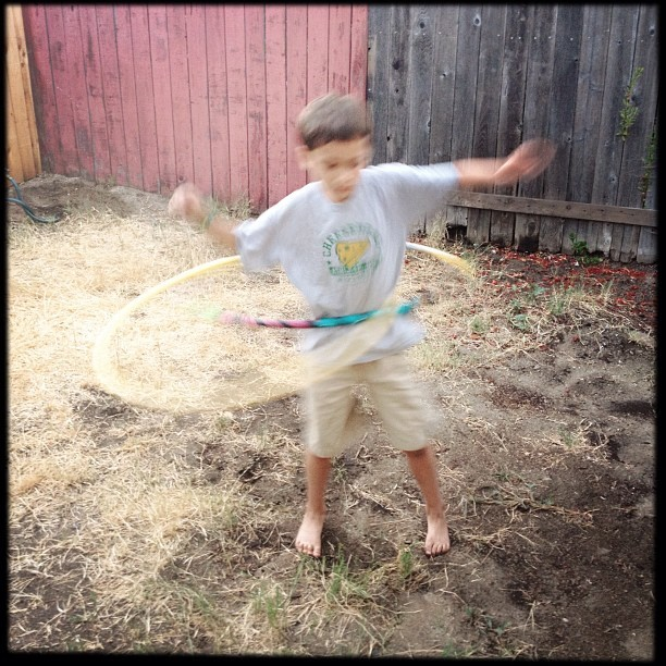 photo by Mike Ambs - xander finally got the hang of hooping - and jumped right up to two hoops at once :) cc @freeplaylife